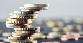 zeigt einen Stapel Geldmünzen